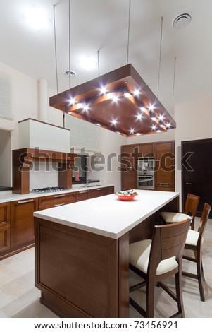 Interior to modern kitchen in brown tone - stock photo