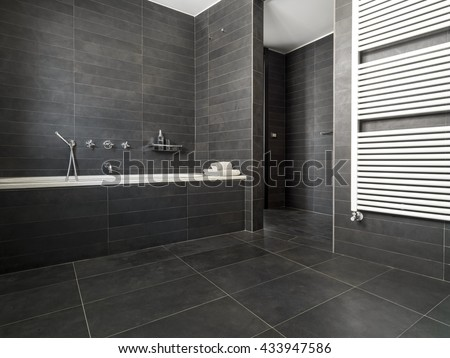 interior view of a modern bathroom in foreground the bathtub - stock photo
