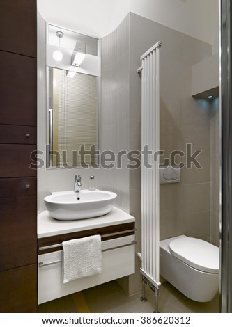 interior view of a modern bathroom in foreground the washbasin and the radiator
