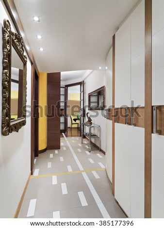interior view of a modern corridor with wall cupboard and tiles floor
