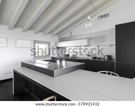 interior view of a modern kitchen in the attic room - stock photo