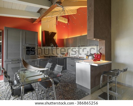 interior view of a modern kitchen with glass dining table - stock photo