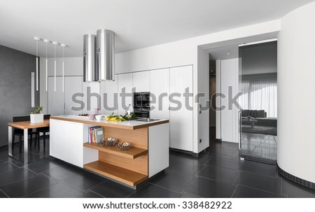 interior view of a modern kitchen with kitchen island - stock photo