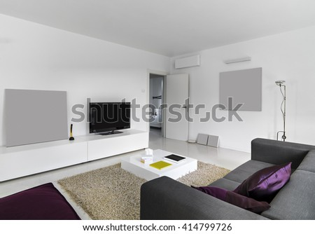 interior view of a modern living room with television overlooking on the bedroom - stock photo