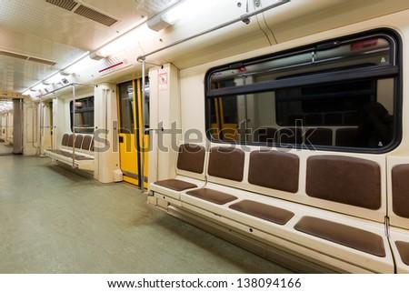 Interior view of a subway car - stock photo