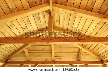 Interior view of a wooden roof structure - stock photo
