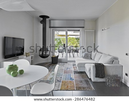 interior view of modern living room overlooking on terrace - stock photo