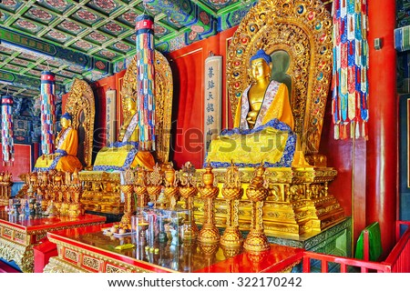 "Interior view of Yonghegong Lama Temple.Beijing. Lama Temple is  largest and most important Tibetan Buddhist monasteries in the world.Inscription (translation)-Pavilion of Ten Thousand Happinesses"". - stock photo"