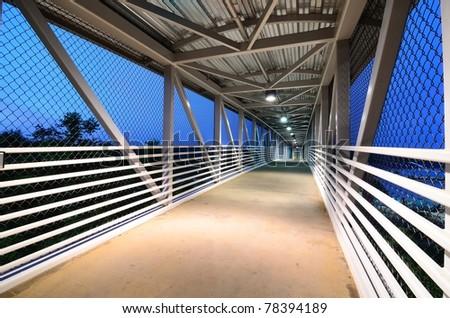 Interior walkway of a footbridge. - stock photo