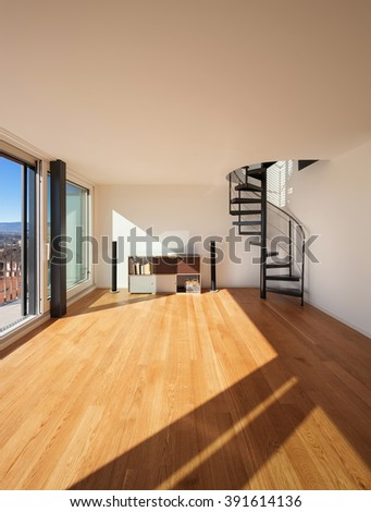 Interior, wide open space of a duplex, parquet floor - stock photo