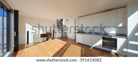 Interior, wide open space of a loft, kitchen and living - stock photo