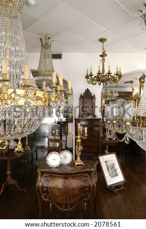 Interior with antiques and chandelier - stock photo