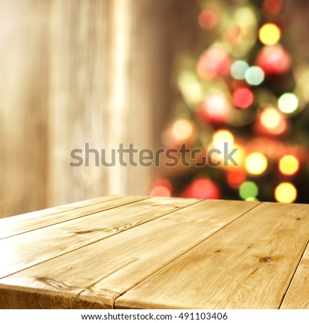 interior with blurred xmas tree and wooden old table place