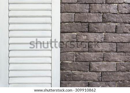 interior with brick wall and wood wall - stock photo