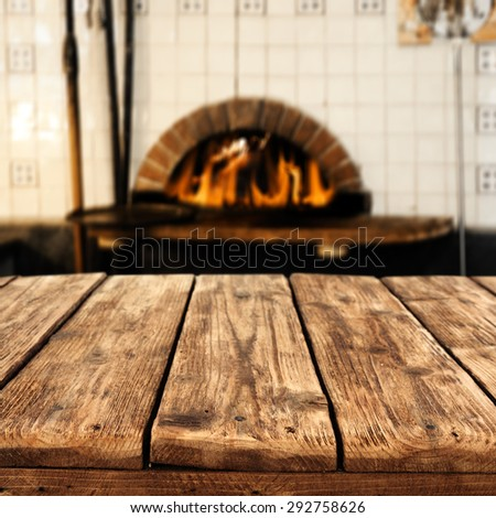 interior with fireplace and old worn wooden board  - stock photo