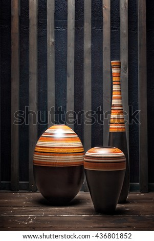 Interior with three vases wooden floor near the wall - stock photo