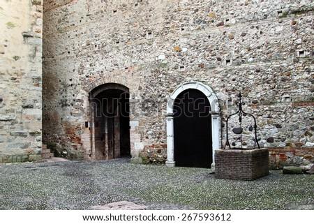 Interior with well in the Castello Scaligero di Sirmione (Sirmione Castle), Lake Garda, Sirmione, Italy - stock photo