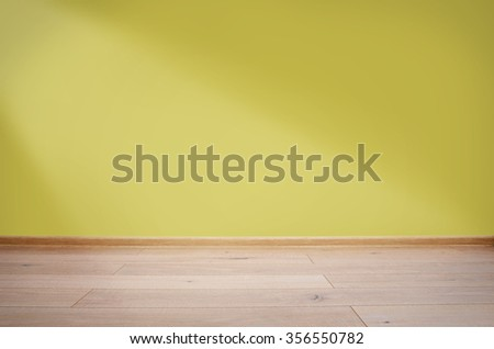 Interior with yellow wall and wooden floor - stock photo