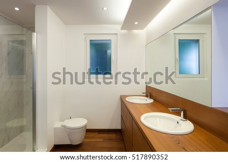 Interiors, comfortable bathroom with two sinks and parquet floor