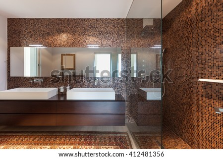 Interiors of new apartment, bathroom, tiled walls - stock photo