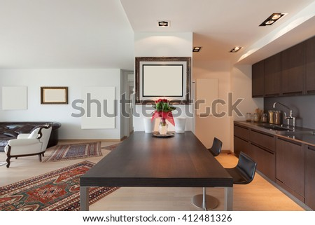 Interiors of new apartment, table of the modern domestic kitchen  - stock photo