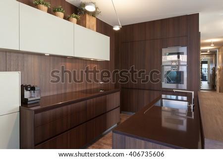 Interiors of new apartment, wooden kitchen modern design - stock photo
