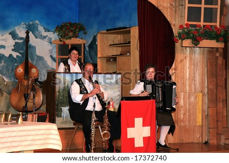 INTERLAKEN, SWITZERLAND - DECEMBER 15: Traditional Swiss folk musical performance with a variety of instruments December 15, 2007 in Interlaken, Switzerland. - stock photo