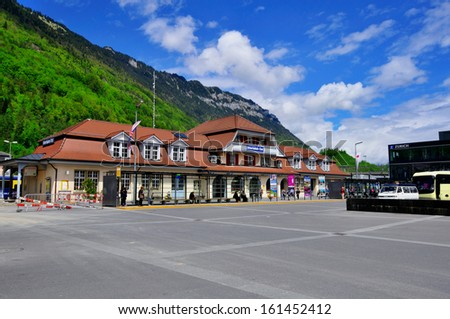 INTERLAKEN, SWITZERLAND - MAY 09: Facade of Interlaken railway station on May 09, 2012. Interlaken is a town and municipality in the Interlaken-Oberhasli in the canton of Bern.