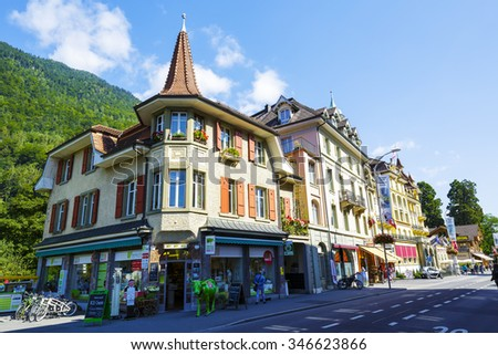INTERLAKEN, SWITZERLAND - SEPTEMBER 07, 2015: Picturesque townhouses in a very important tourist spot. The ground floor store (Swiss Mountain Market) offers Regional specialties and aromatherapy  - stock photo