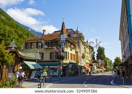 INTERLAKEN, SWITZERLAND - SEPTEMBER 07, 2015: Picturesque townhouses. The town with a population of about 6000 attracts many tourists because of its charm and location in a very important tourist spot - stock photo