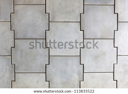 Interlocking concrete wall sections under a freeway - stock photo