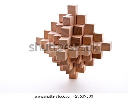 Interlocking wooden burr isolated on white - stock photo