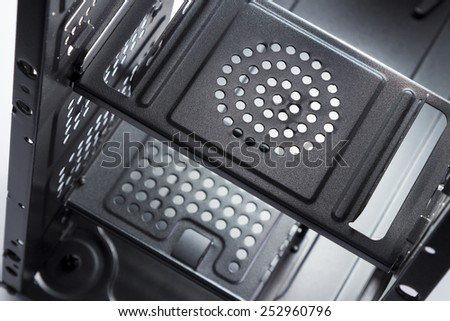 Internal part of the computer casing. Places for installation of hard drives and solid-state drives in the computer case. Black computer casing.  - stock photo