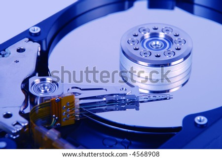 Internal view of hard disc drive with blue tone - stock photo