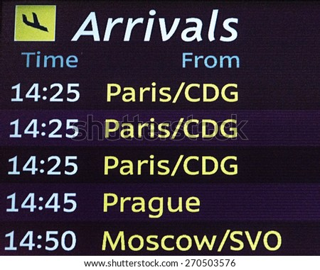 International arrivals board panel . from everywhere - stock photo