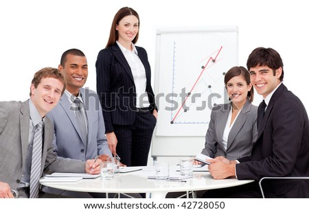 International business people at a presentation smiling at the camera
