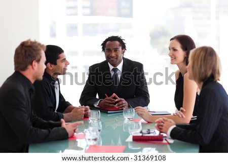 International business people discussing in a meeting - stock photo