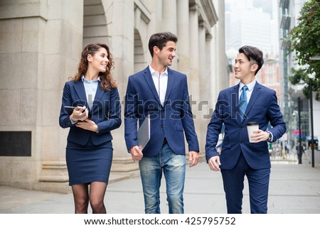 International business people talking at outdoor - stock photo