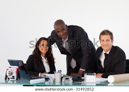 International business team in an office smiling at the camera