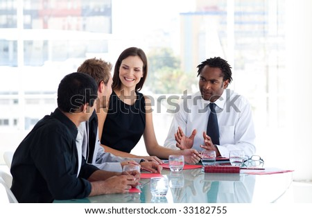 International business team interacting to each other in office
