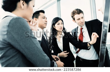 International business team on flipboard - stock photo
