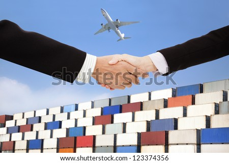 international business trade and transportation concept.businessman and businesswoman handshaking with containers background - stock photo