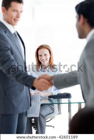 International businessmen greeting each other at a job interview in an office - stock photo