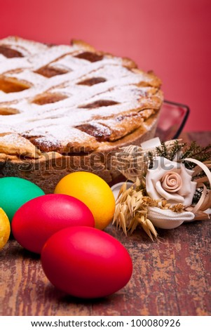 International Cuisine - Desserts - Neapolitan Pastiera and colorful Easter eggs. Pastiera is a wheat and ricotta pie that is also known as Pizza Gran.