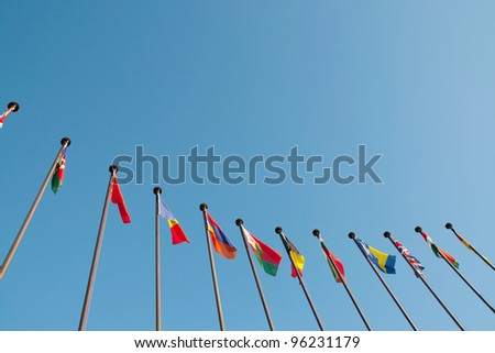 International Flags against blue sky - stock photo