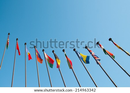 International Flags against blue sky background