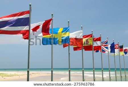 International flags on the beach - stock photo