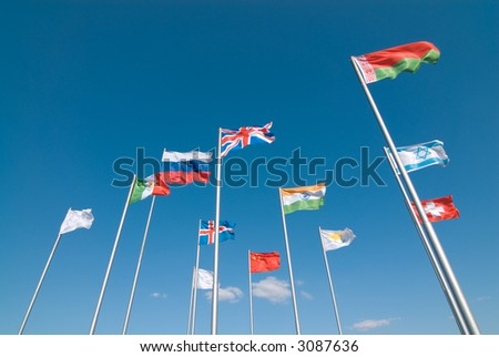 International flags waving across the deep blue sky