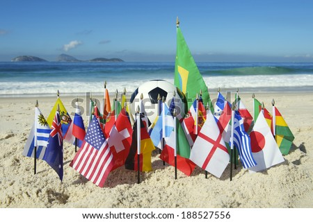 International football country team flags with soccer ball on Ipanema beach in Rio de Janeiro Brazil  - stock photo