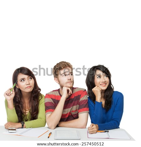 International group of young students studying and thinking together - stock photo